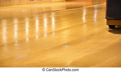 Ice machine. - Ice machine cruises over ice rink and clean...