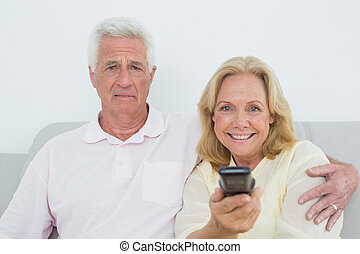 Senior couple watching television - Relaxed senior couple...