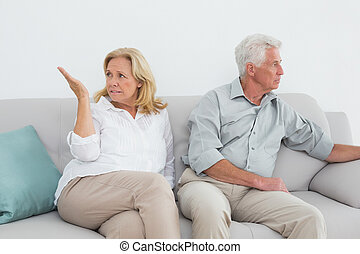 Displeased relaxed senior couple at home - Displeased...