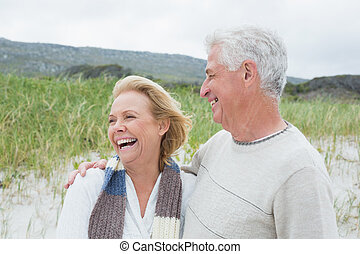 Cheerful senior couple at beach