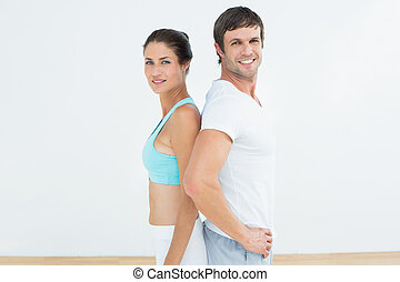 Portrait of a fit couple in fitness studio - Portrait of a...