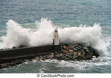 Waves - waves break on the lighthouse at Camogli