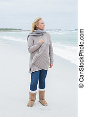 Contemplative casual senior woman at beach - Full length of...