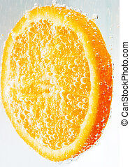 Bubbly orange slice. - An orange slice covered with and...