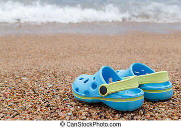 Blue sandals slipper on the sand - Pair of blue slippers...