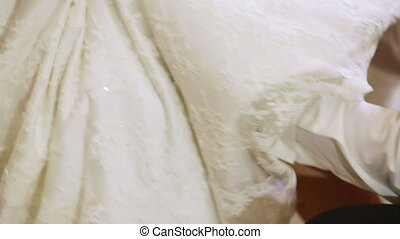 Removing garter - Groom removes garter from bride in yellow...