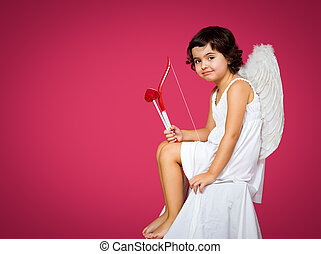 cupid little girl with a bow, arrow and wings