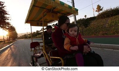 Family in a Pedal Bus 1 - 1) Glidecam video shot of a family...