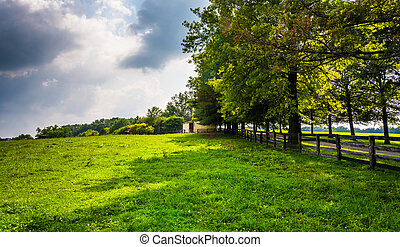 Farm fields and trees in rural Southern York County, Pennsylvania.