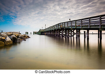 Fishing pier and jetty in Chesapeake Beach, Maryland. -...