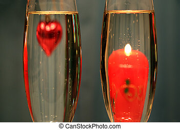 heart and candle in glasses with champagne