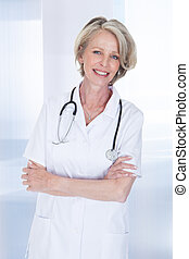 Portrait Of Happy Mature Female Doctor With Stethoscope