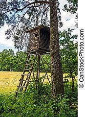 Hunter hut - Wooden observation hunter hut in Czech forest
