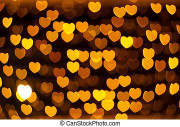 defocused heart lights - defocused golden lights in the...