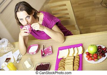 Woman drinking coffee for breakfast