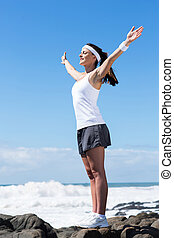 young woman stretching arms up