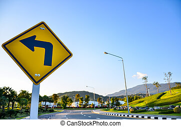 Turn left traffic sign on road