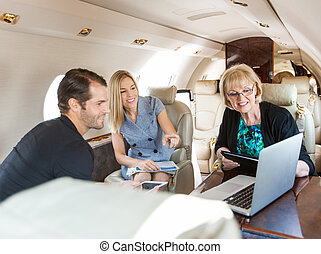 Business People Working In Private Jet - Businesswoman...