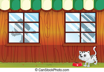 A kitten eating outside the house - Illustration of a kitten...