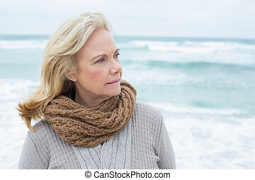 Contemplative senior woman relaxing at beach - Close-up of a...