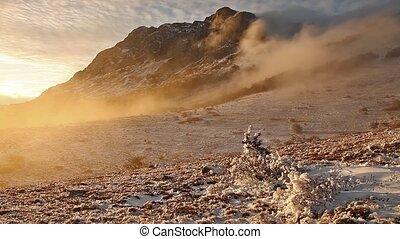 Fog descending the mountain slope