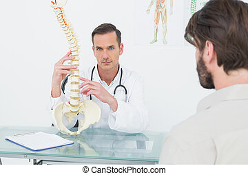 Portrait of a doctor explaining the