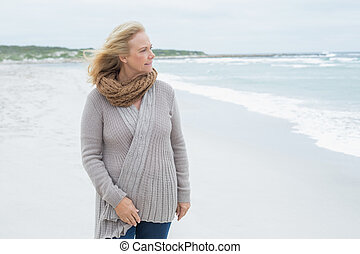 Casual senior woman looking away at beach - Contemplative...
