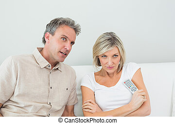 Couple watching tv in the living room