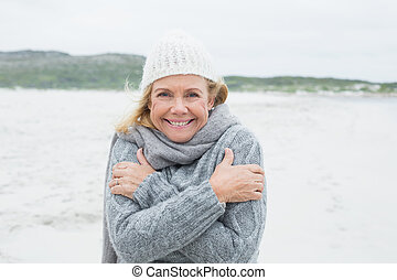Happy senior woman feeling cold at - Portrait of a happy...