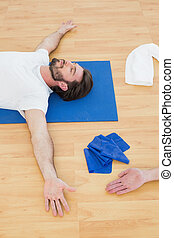 High angle view of a man relaxing with eyes closed