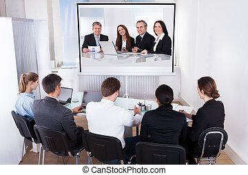 Group Of Businesspeople In Video Conference - Group Of Male...