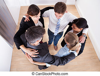 Businesspeople Making Huddle - High Angle View Of...