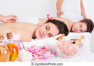 Couple Receiving An Acupuncture Treatment