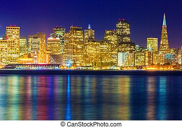 San Francisco sunset skyline California bay water reflection...