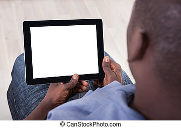 African Person Sitting With Digital Tablet - Close-up Of...