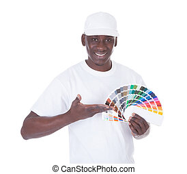 African Painter With Color Swatch - African Painter Holding...