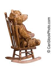 old teddybear on wooden chair