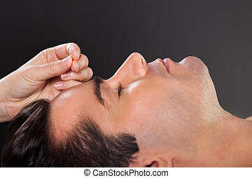 Man Getting Acupuncture Treatment - Close-up Of A Young Man...
