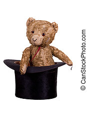 old teddybear sitting in old black hat