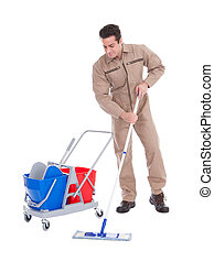 Male Sweeper Cleaning Floor - Young Male Sweeper Cleaning...