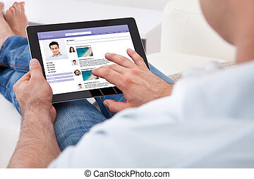 Man Using Digital Tablet - Close-up Of Man Browsing On...