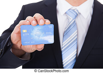 Businessman Holding Credit Card - Close-up Of Young...
