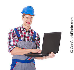 Architect Using Laptop - Portrait Of Young Male Architect...