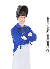 Portrait Of A Male Welder With Protective Workwear Over...
