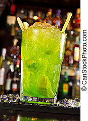 Green apple cocktail on the bar counter