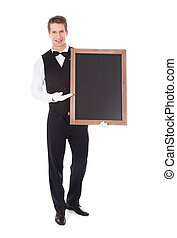Male Waiter Holding Chalkboard - Young Male Waiter Holding...