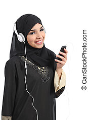 Saudi arab woman listening to the music from a smart phone...