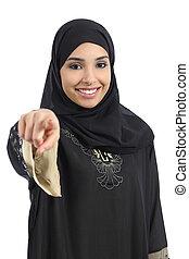 Saudi arab woman pointing at you and looking at camera...