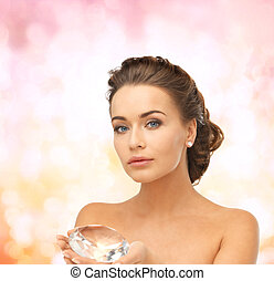 woman showing big diamond - close-up of beautiful woman with...