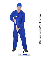Worker In Boilersuit Cleaning Floor - Mature Male Worker In...